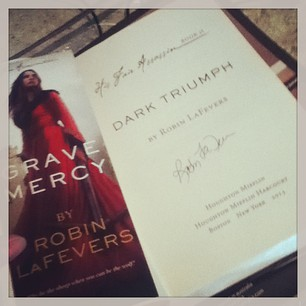 A signed copy of Dark Triumph by Robin Lafevers