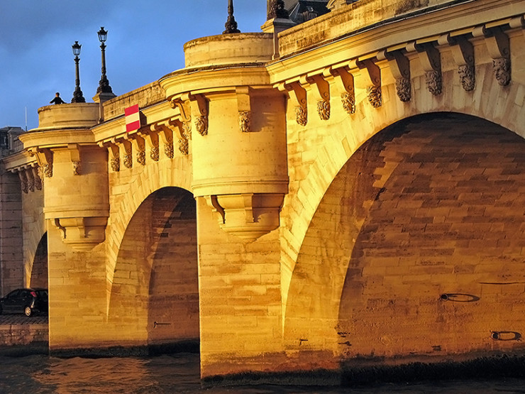 """Pont Neuf at Sunset"" by Steve from washington, dc, usa - the pont neuf glowing at sunset. Licensed under CC BY-SA 2.0 via Wikimedia Commons."